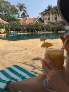The Raffles pool and a delicious drink of mango and lime juice.